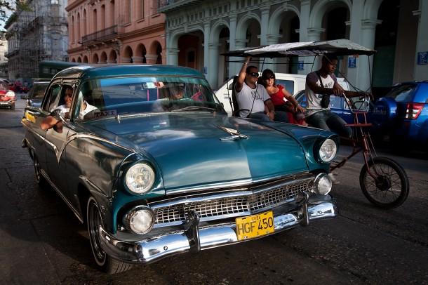 Vintage car and bike taxi. Havana (La Habana), Cuba